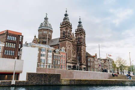 Amsterdam, Netherlands September 5, 2017: Nice and huge St. Nicolas church in Amsterdam city center near the main railway station on the canal's embankment