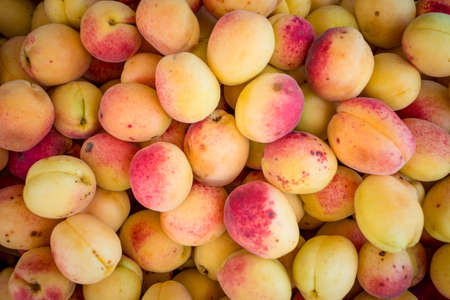 A group of ripe peaches