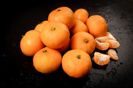 Group of mandarins on black