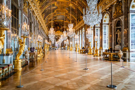 VERSAILLES, FRANCE - February 14, 2018 : The hall of mirrors  in the central wing of Palace of Versailles, the residence of the sun king Louis XIV Editöryel
