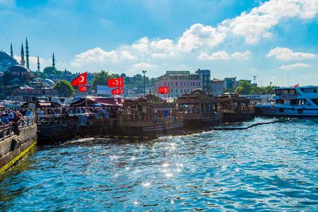 ISTANBUL, TURKEY - July 11 2017 :  Fish sandwich buffet on the water near Galata bridge on July 11, 2017 in Istanbul, Turkey