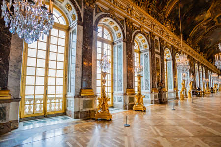 VERSAILLES, FRANCE - February 14, 2018 : The hall of mirrors  in the central wing of Palace of Versailles, the residence of the sun king Louis XIV Editorial