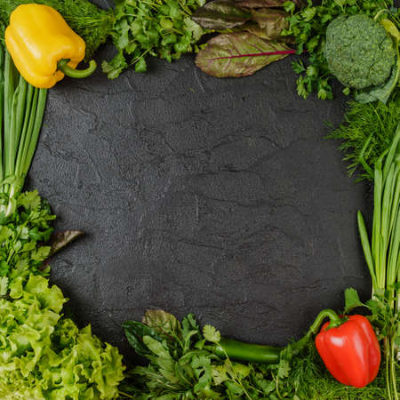 Healthy food. Vegetables  On a black wooden 写真素材