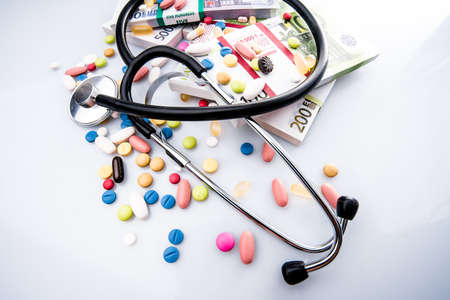 Medical pills, stethoscope  in euro money Stock Photo