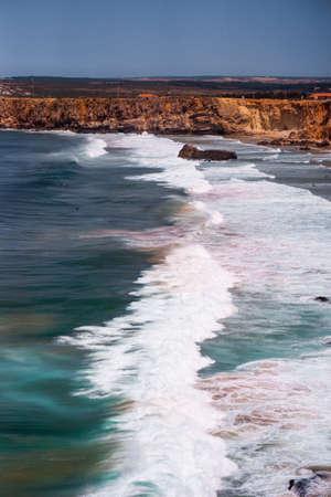 Beautiful coast of Portugal. cliff into the Atlantic Ocean Фото со стока