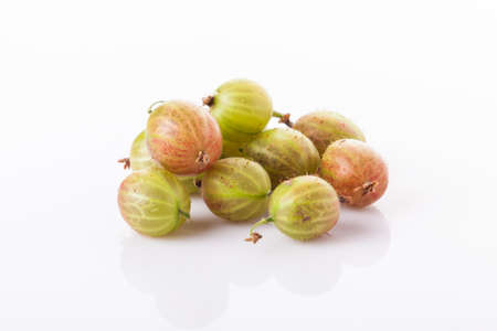 heap of green gooseberries isolated on white background Imagens