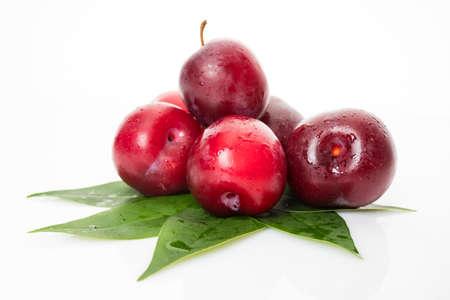 Fresh plum isolated on white Banco de Imagens