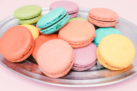 Colorful almond cookies  on pink