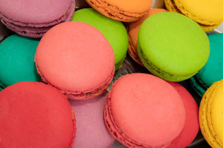 French Colorful Macarons on Pink