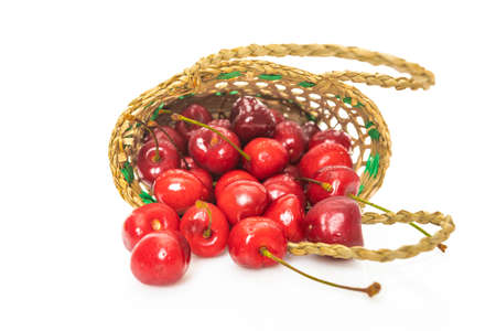 Cherry in basket isolated on a white
