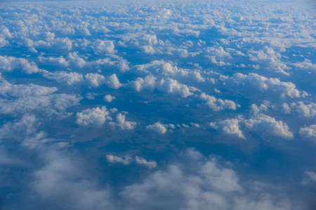 Sky and clouds from above the ground viewed from an airplane Banco de Imagens