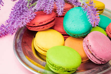 Tasty colorful macarons on pink Banco de Imagens