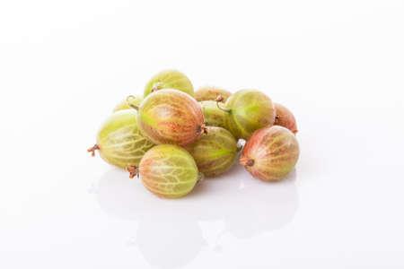 Heap of green gooseberries isolated on white