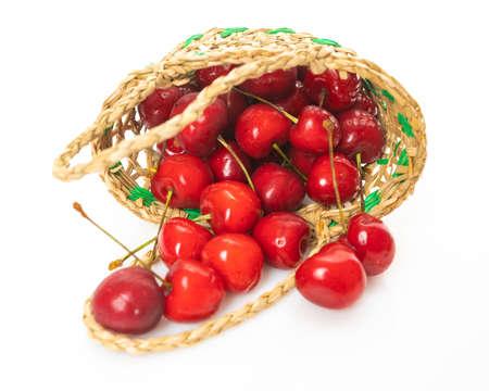 Basket of fresh sour cherries isolated on white Banco de Imagens