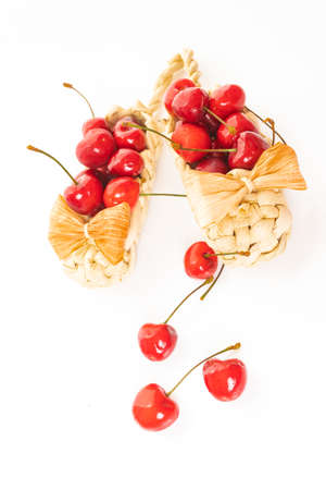 Cherry in basket isolated on white