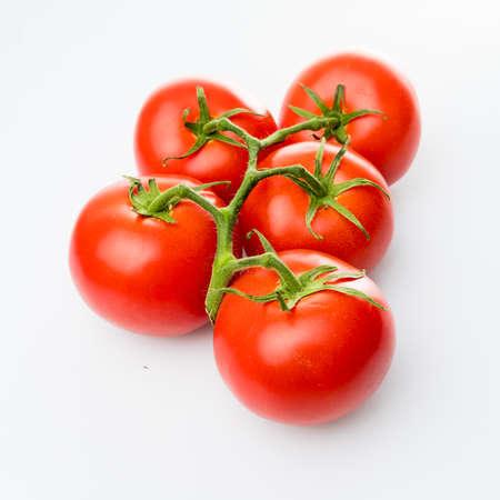 Tomatoes isolated on white Banco de Imagens