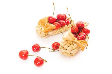 Basket of fresh sour cherries isolated on white Reklamní fotografie