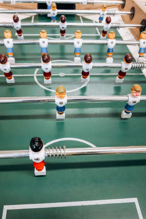 Table football game with red and blue players. Football game. Banco de Imagens