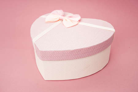 Heart shape gift box on a pink background