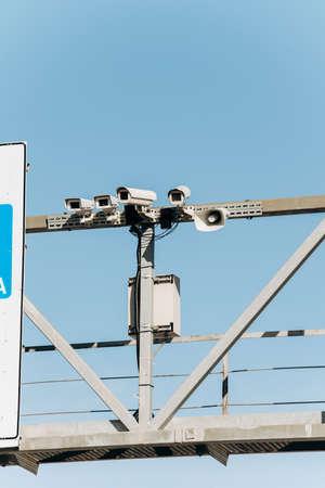 Security cameras on a pole near the road. CCTV camera