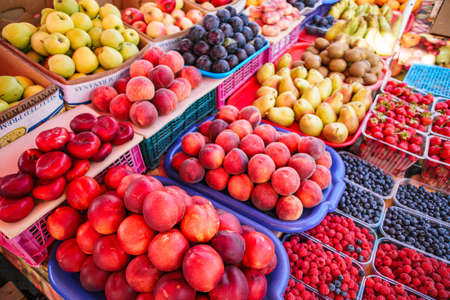 Fresh, juicy fruits at a market under the open sky