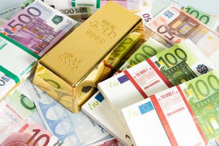 Gold bars, Financial, business investment concept. Euro Money Фото со стока