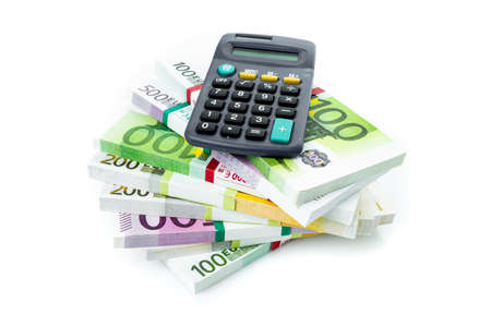 Euro money and calculator isolated on white
