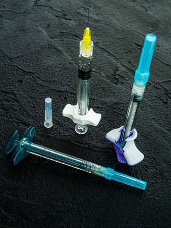 A set of different syringes on lack. Face Cosmetics Injecting