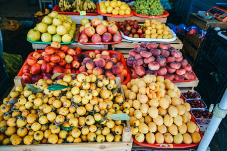 Fresh fruit in the market. Apricots, peaches on the market.
