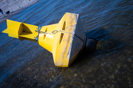 Yellow Anchor buoy on drought river