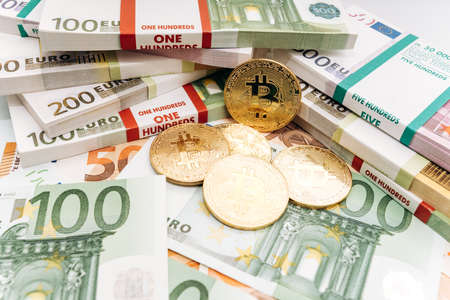 Crypto currency concept - a bitcoin with euro bills. Bitcoin and Euro banknotes. Cryptocurrency lies on the money Stock Photo