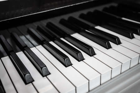 Close-up of black and white piano keys.