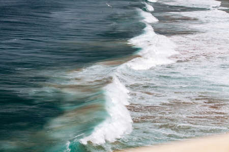 Beautiful sea waves. Waves on a Sunny day. View of the waves from above