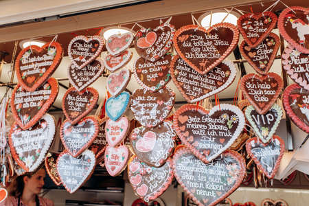 Gingerbread Hearts at the German Christmas Market. Traditional gingerbread with different inscriptions in German at a fair in Germany