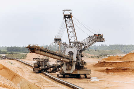 Giant bucket wheel excavator. The biggest excavator in the world. The largest land vehicle. Excavator in the mines. Stock Photo