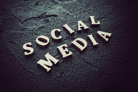 Social media text written on black background