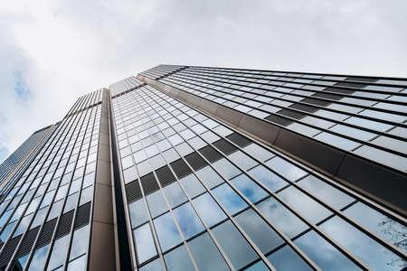 Blue skyscraper facade. office buildings. modern glass silhouettes