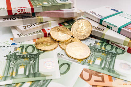Crypto currency concept - a bitcoin with euro bills. Bitcoin and Euro banknotes. Cryptocurrency lies on the money Stock fotó