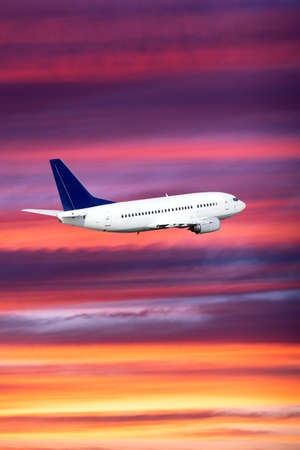airplane on sunset background. Passenger airliner. Commercial aircraft. Private jet