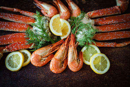 Crab legs on brown rustic background