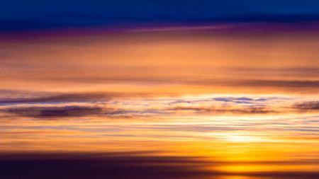 Dramatic sunset and sunrise sky. Fiery orange sunset sky.