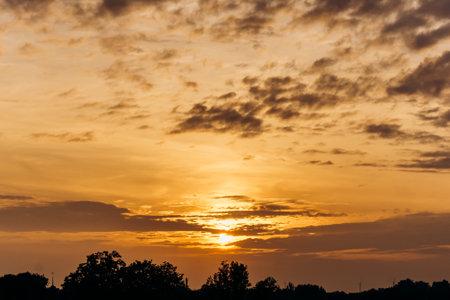 Beautiful sunset. Orange sunset. The moon at sunset 免版税图像 - 161235350