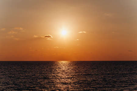 Beautiful sunset above the sea. Reflection of sunset in the water.