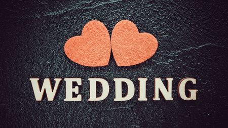 Red Hearts On A Black Board. Creative wedding concept 免版税图像