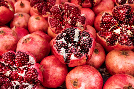 Cracked pomegranate. Ripe Pomegranates Background