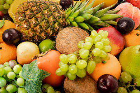 Various assorted juicy fruits. Fresh fruits colorful background. 免版税图像