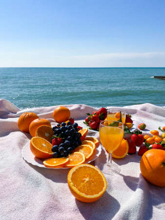 fresh fruit at the beach. Fruits in the sun. Summer time beach concept of healthy eating
