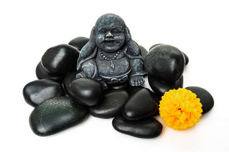 Buddha and stack of black basalt stones