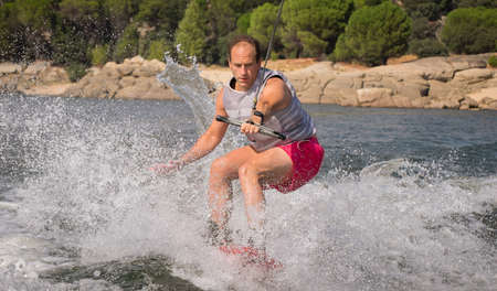Funny wake-boarding sport on the lake Stock Photo