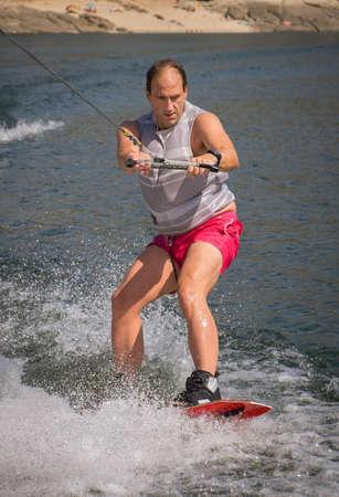 Funny wake-boarding sport on the lake Stock Photo